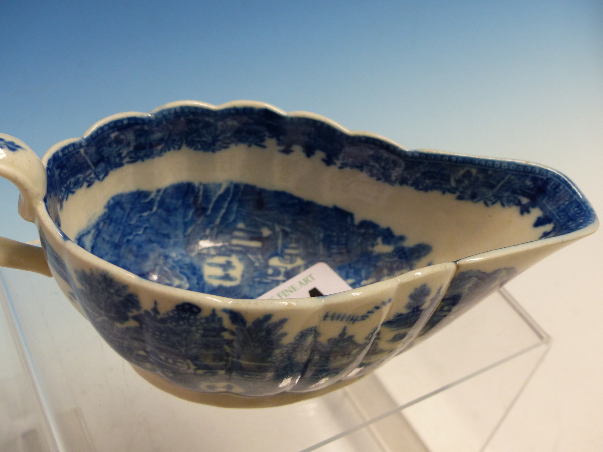 Lot 24 - A CAUGHLEY BLUE AND WHITE SAUCE BOAT PRINTED WITH CHINESE ISLANDS, A DERBY CUSTARD CUP PAINTED