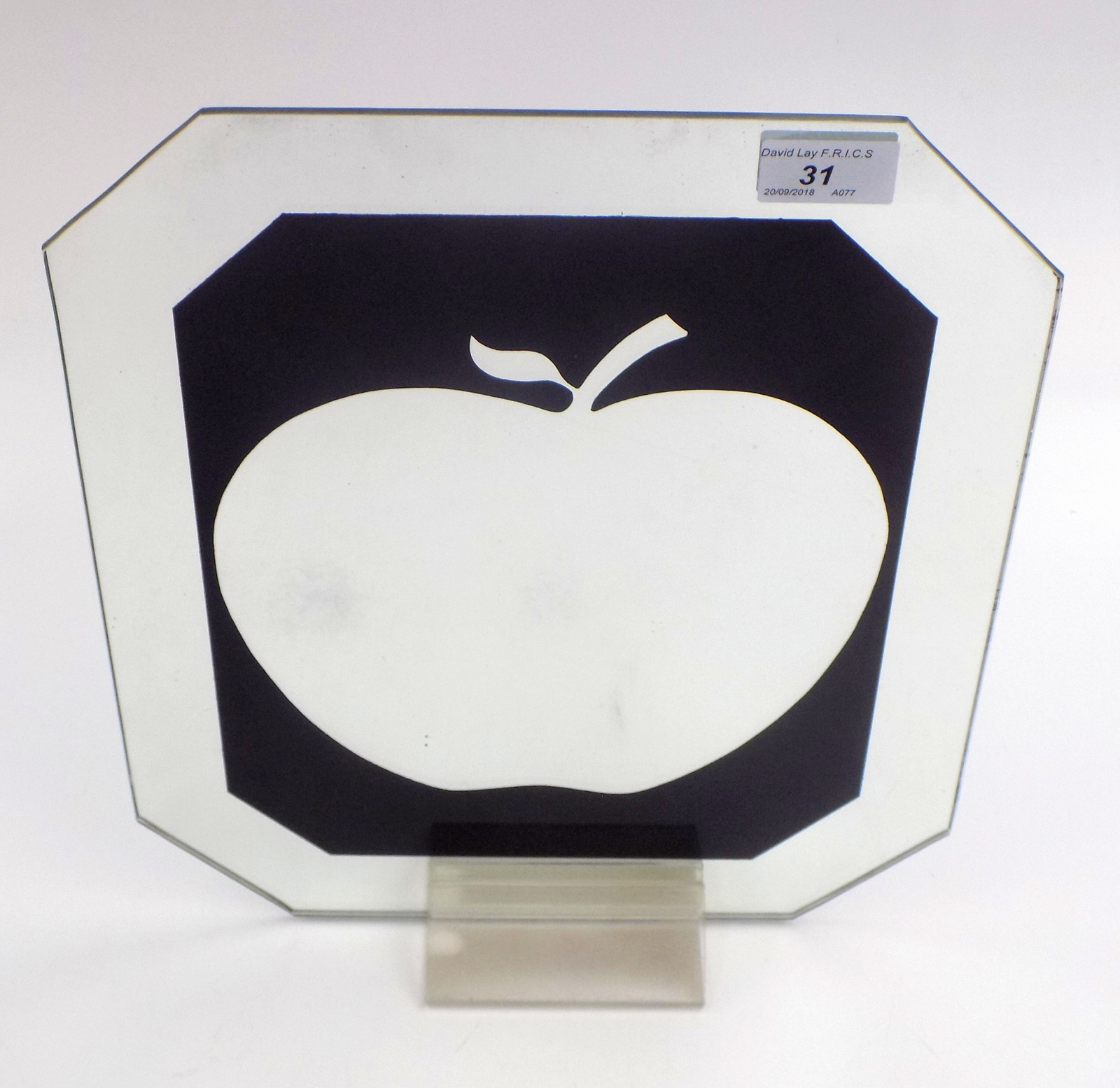 Lot 31 - An Apple Records black promotional mirror, on the original perspex stand, 36 x 29.5cm.