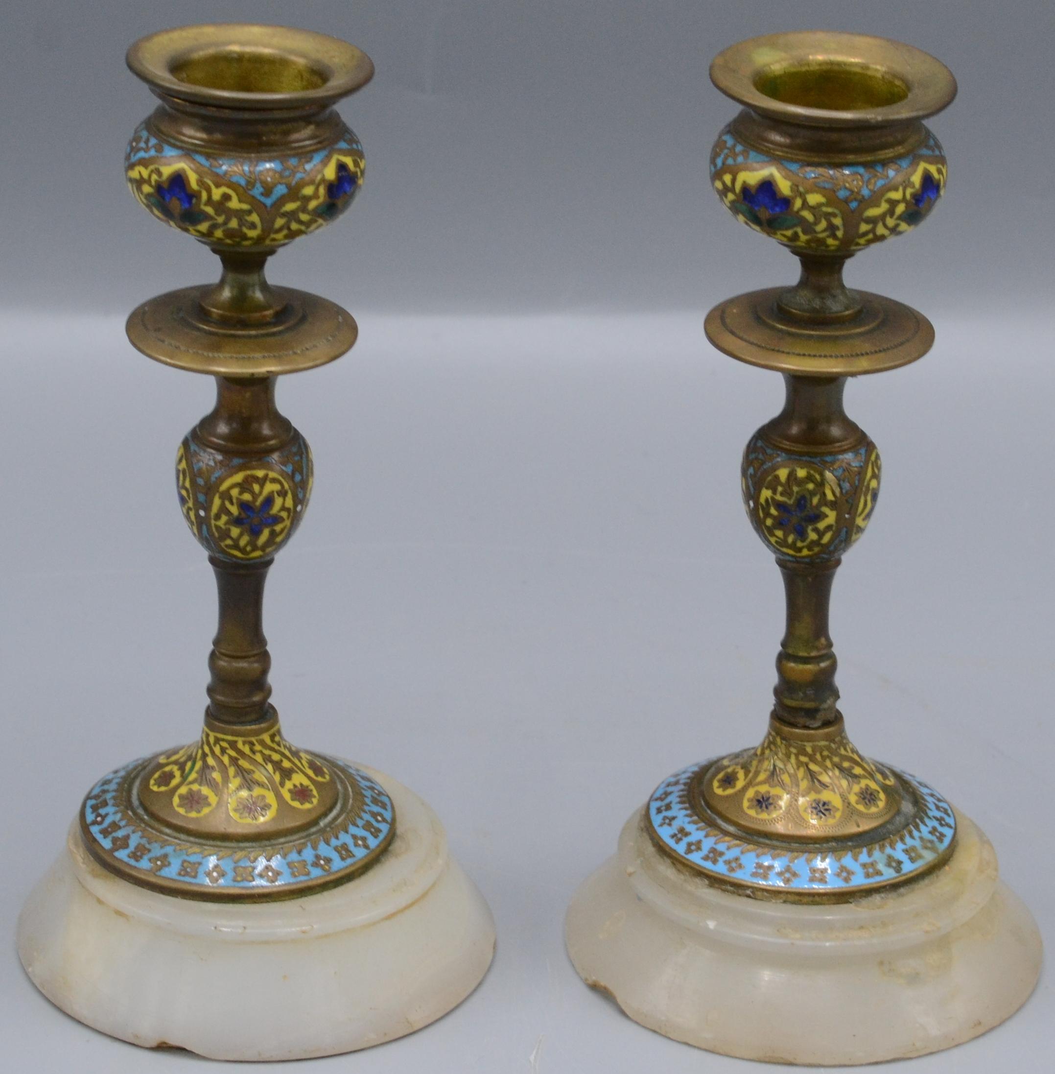 Lot 59 - A pair of continental champleve enamel candlesticks, circa 1900, height 14.5cm, diameter 7.3cm.