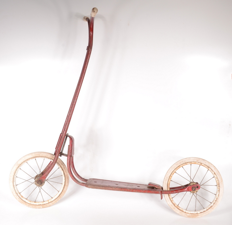 Lot 11 - A red painted metal scooter, white tyres and rubber grips, height 87cm, length 94cm.