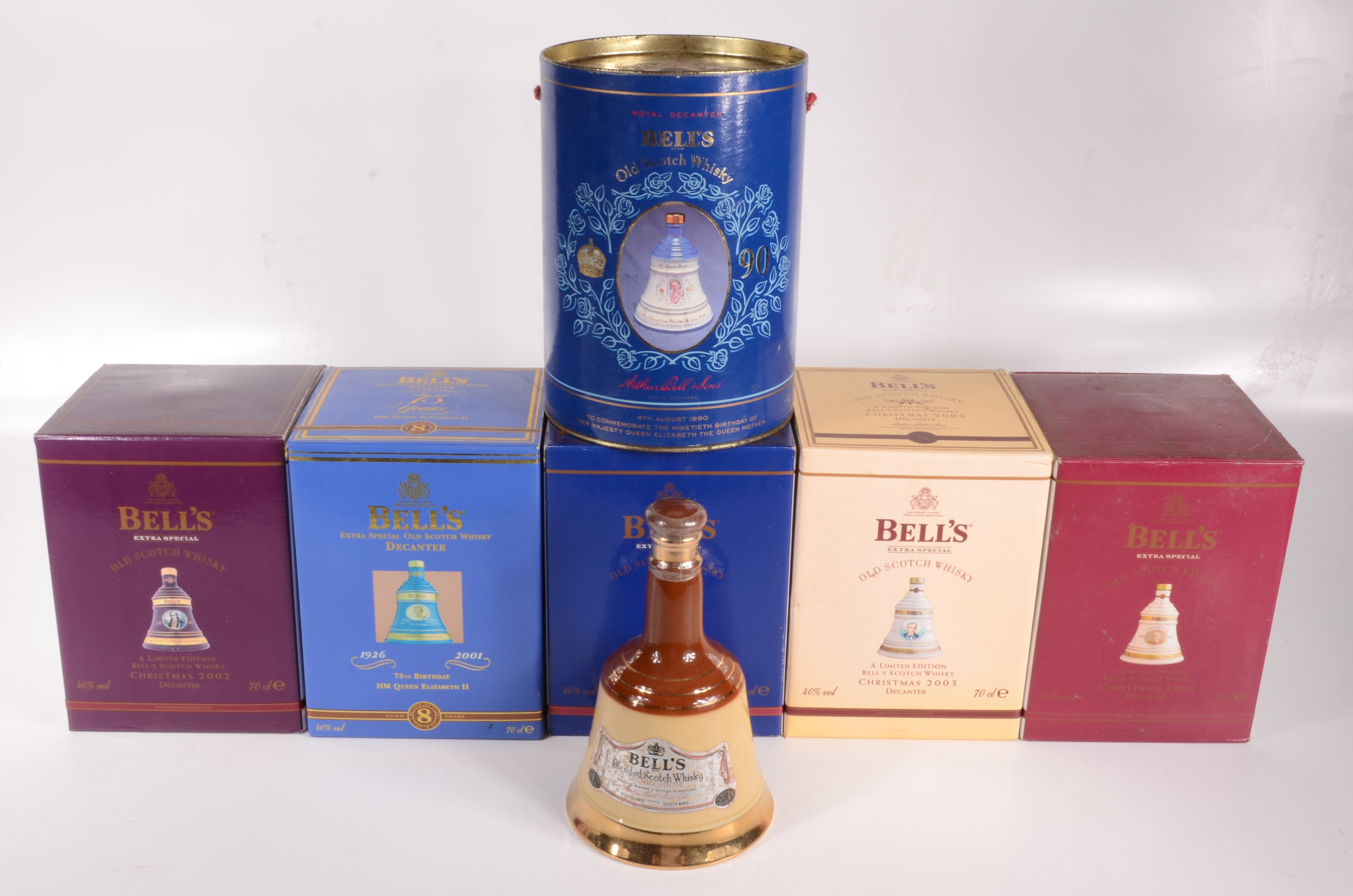 Lot 27 - Four boxed Bell's limited edition Scotch whisky decanters, aged 8 years, Christmas 2000, 2001,
