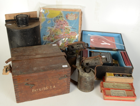Lot 32 - A German magic lantern, with a quantity of rectangular slides in original wooden box,