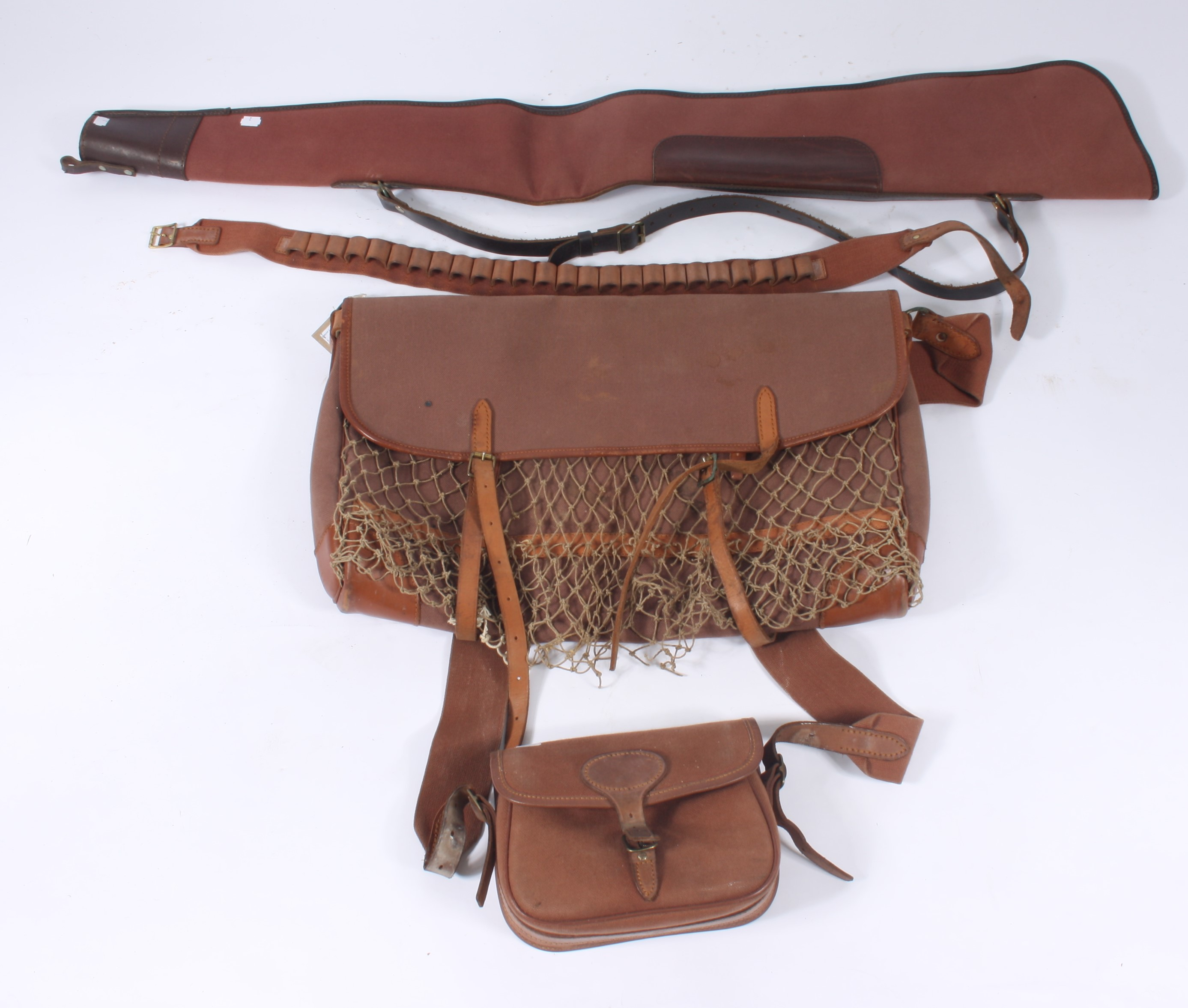 Lot 2 - A Brady of Halesowen brown canvas, net and leather sportsman's bag, height 41cm, width 61cm,