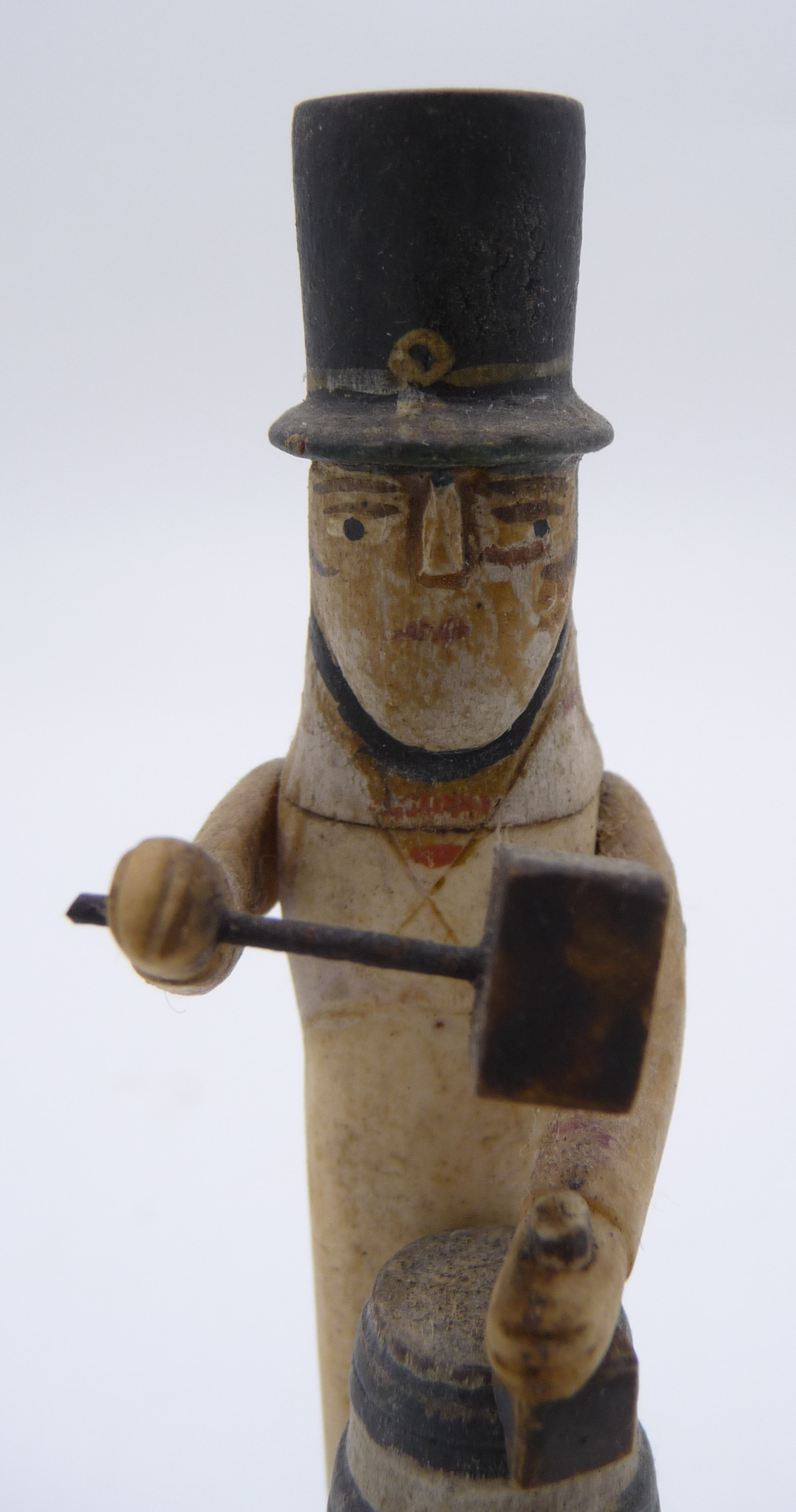 Lot 375 - A Napoleonic French prisoner of war carved bone automaton of a cooper, standing behind a barrel,