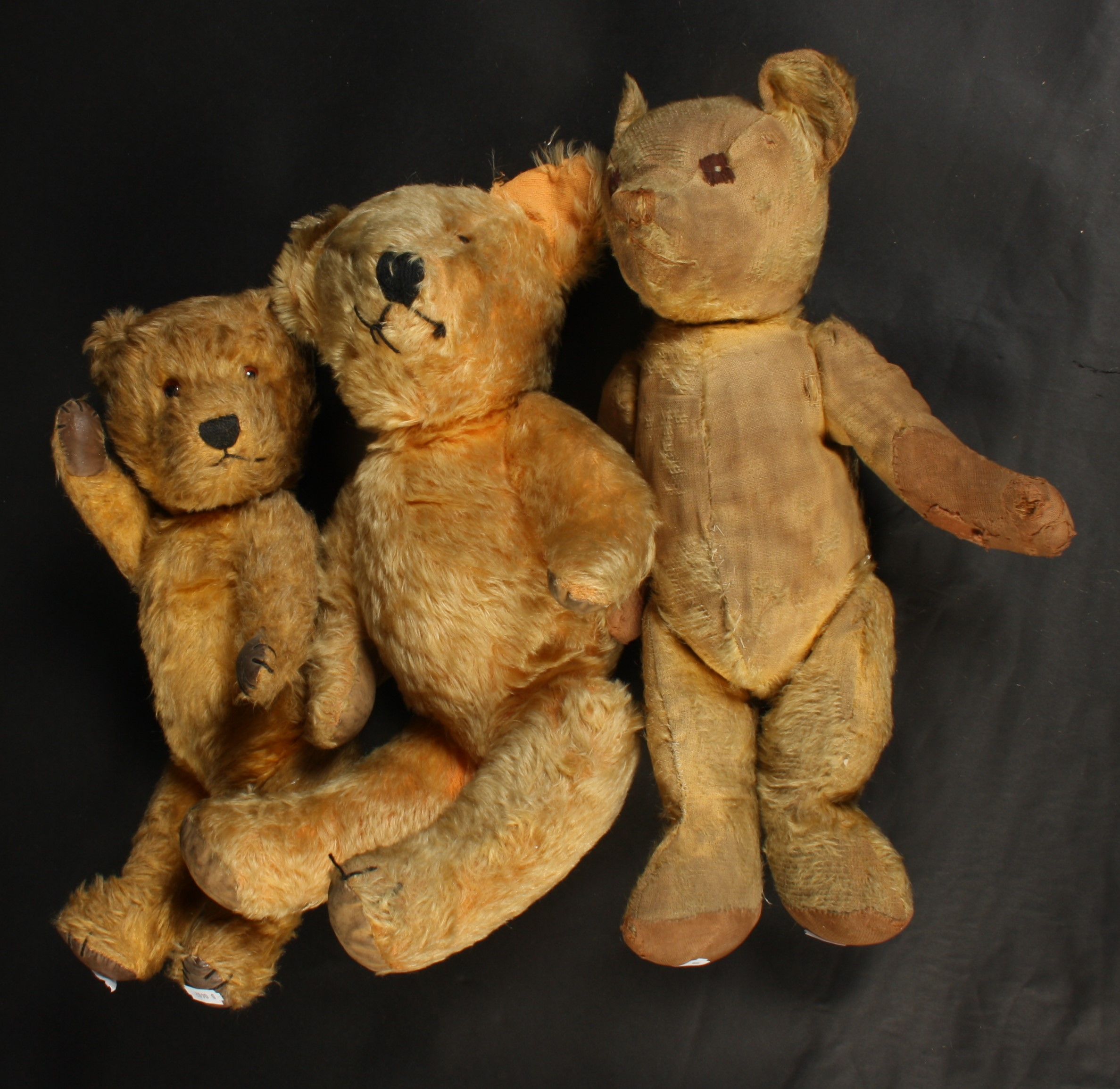 Lot 33 - Three love worn teddy bears, one with 'growler', heights 42cm, 44.5cm and 49cm.