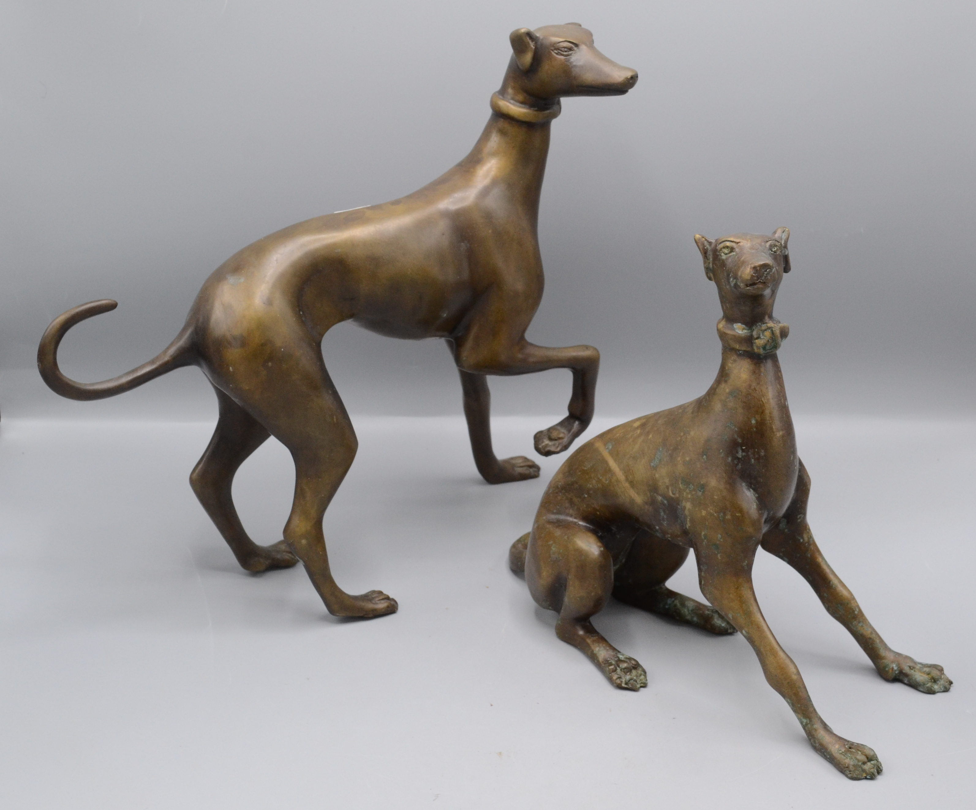 Lot 36 - Two bronze models of greyhounds, one height 32cm, width 33cm, the other height 25cm, width 29cm.