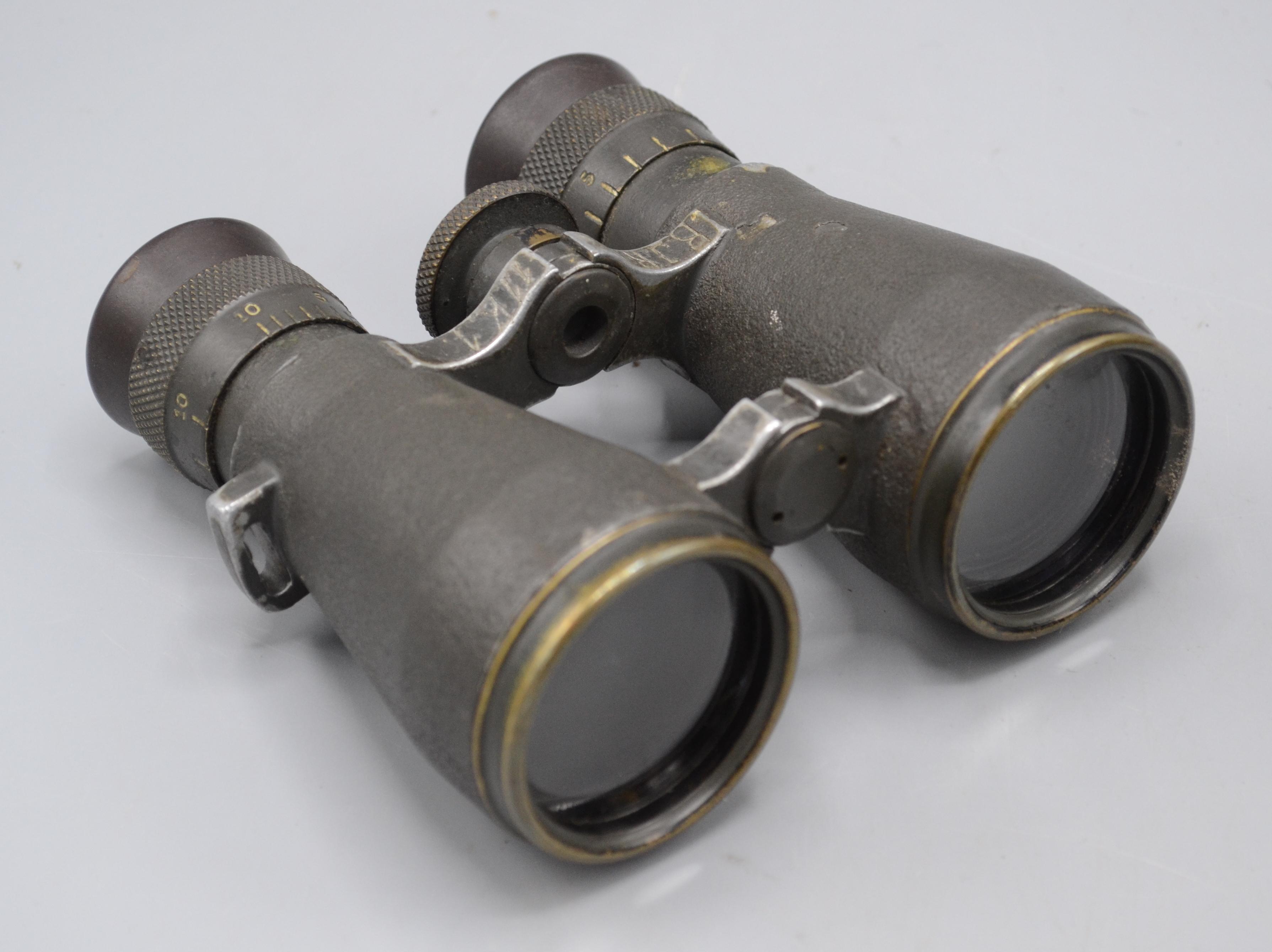 Lot 35 - A pair of German Leitz Wetzler military binoculars, in original leather case, height 11.