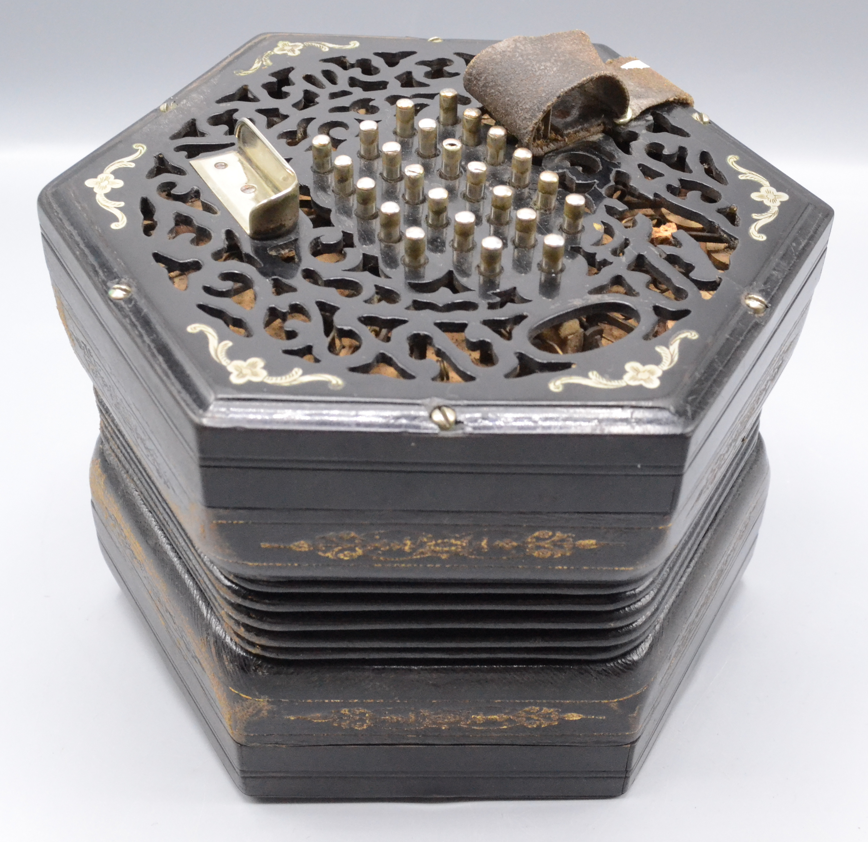 Lot 29 - A Lachenal ebonised concertina, with 48 steel buttons,