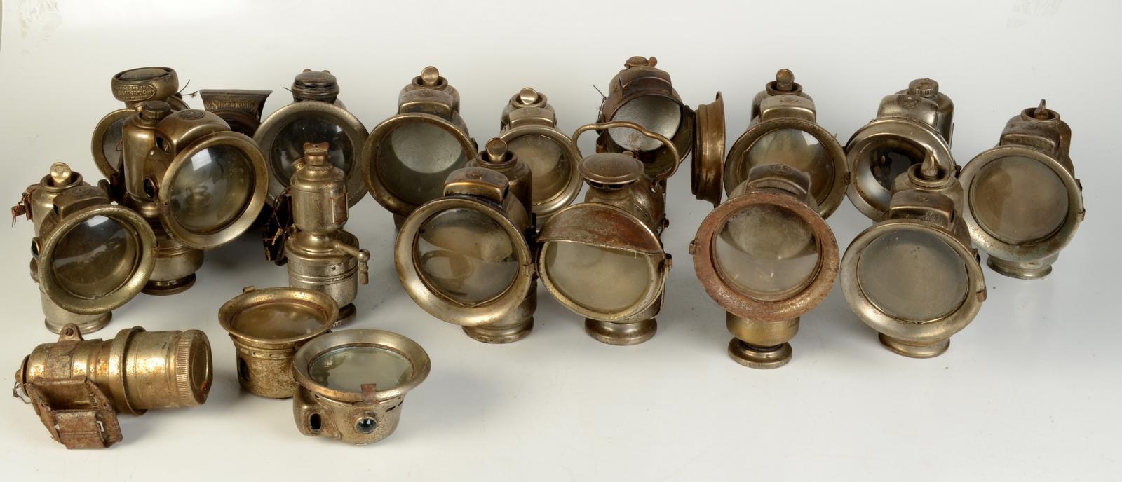 Lot 8 - A collection of seventeen carbide bicycle lamps, including a Lucas Silver King, a Lucas Luminator,