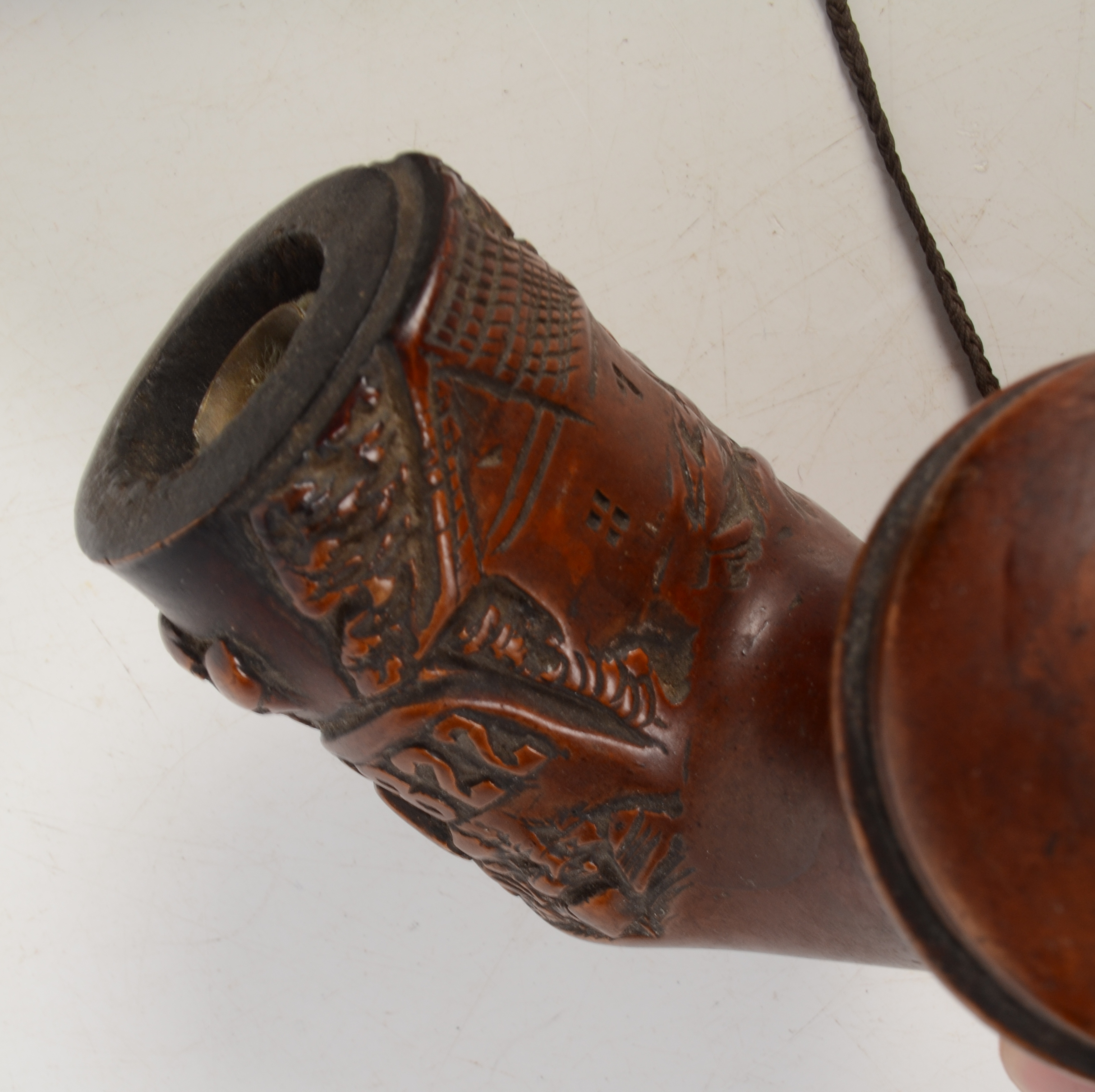 Lot 19 - A wooden pipe, possibly Swiss, carved with a house and a dog and dated 1822, height 11cm.