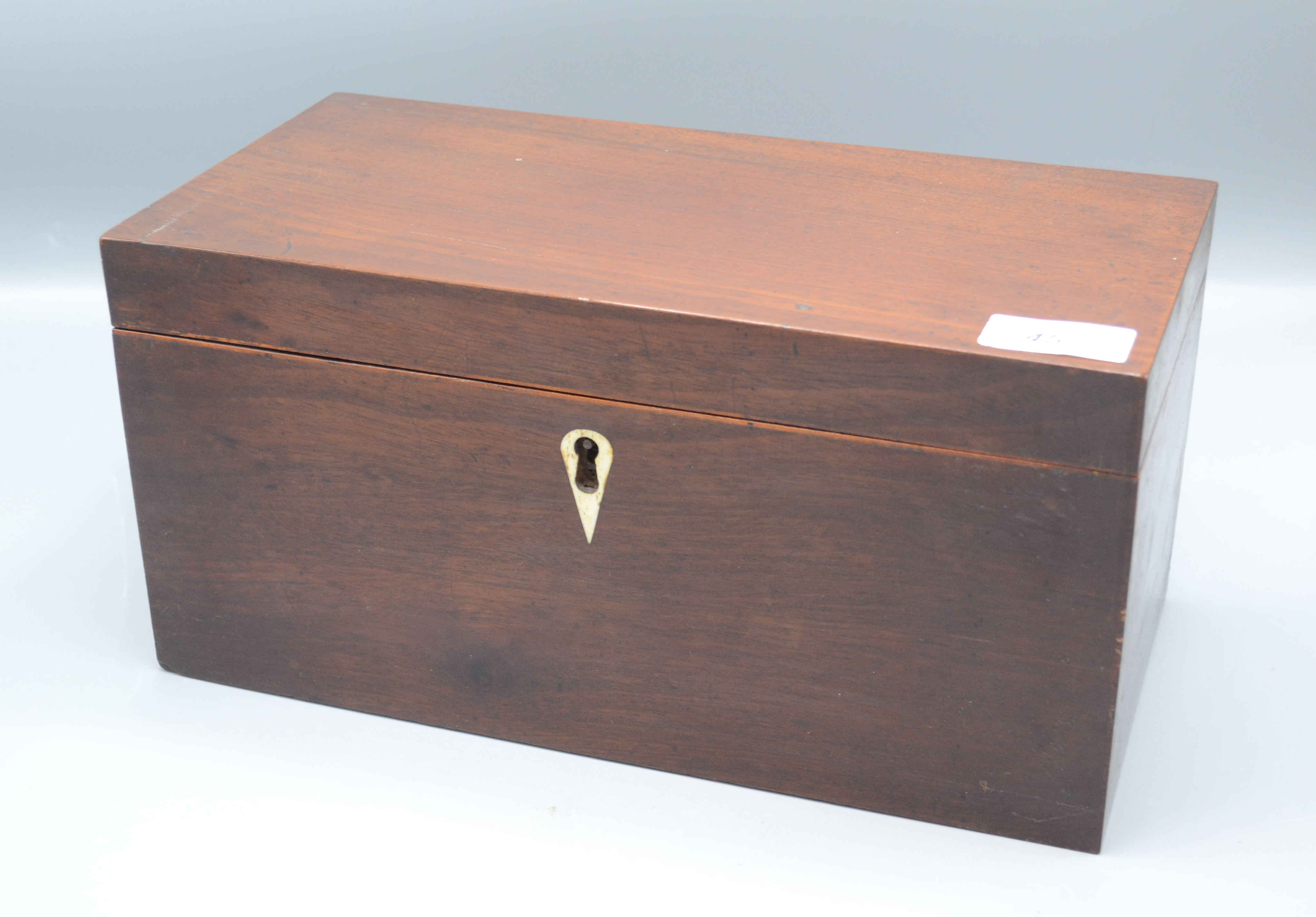 Lot 45 - A Regency mahogany veneered three section tea chest with an engraved glass sugar bowl, height 15cm,