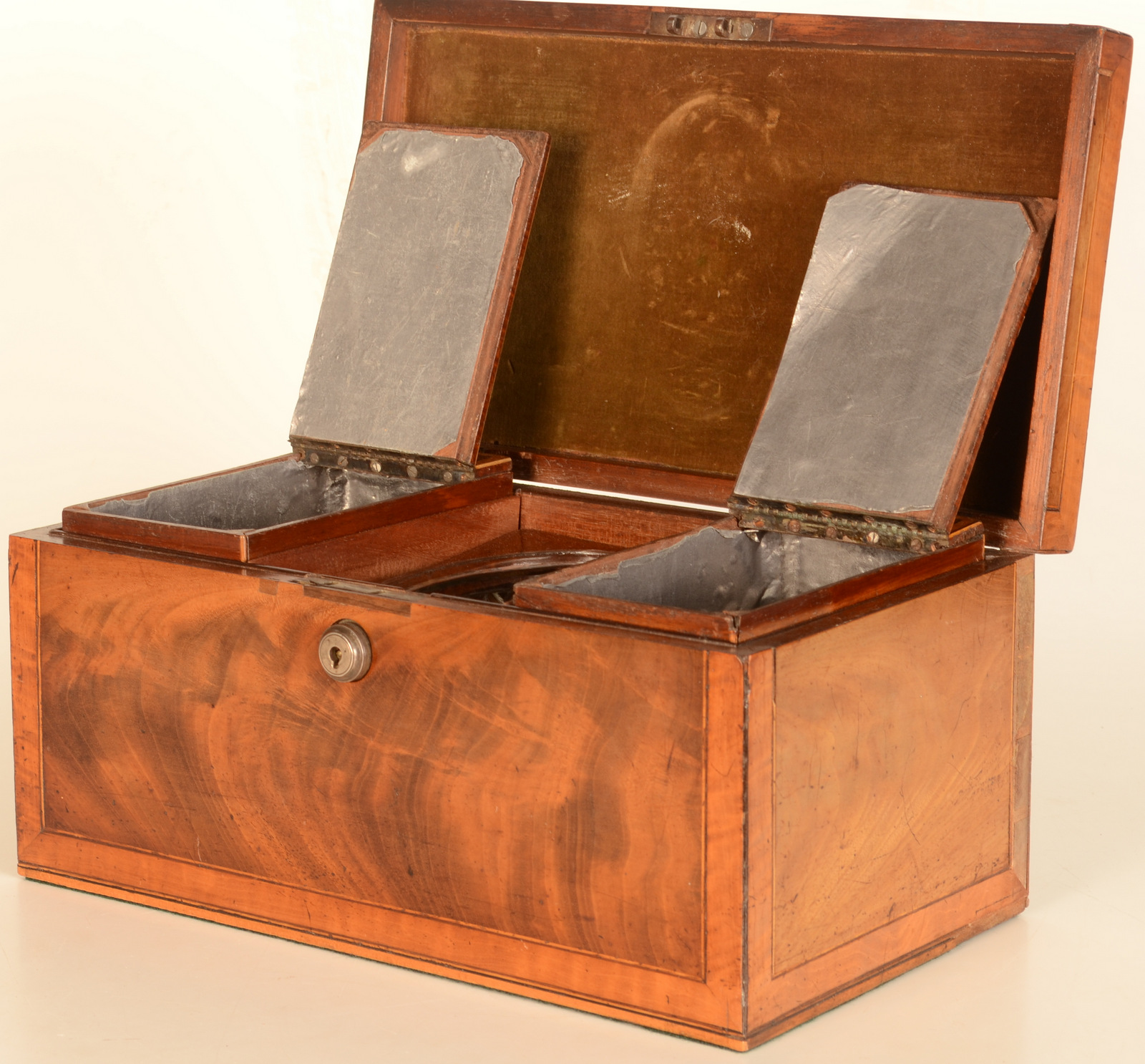 Lot 60 - A Regency crossbanded mahogany three compartment tea chest with silver handle and oval cut glass