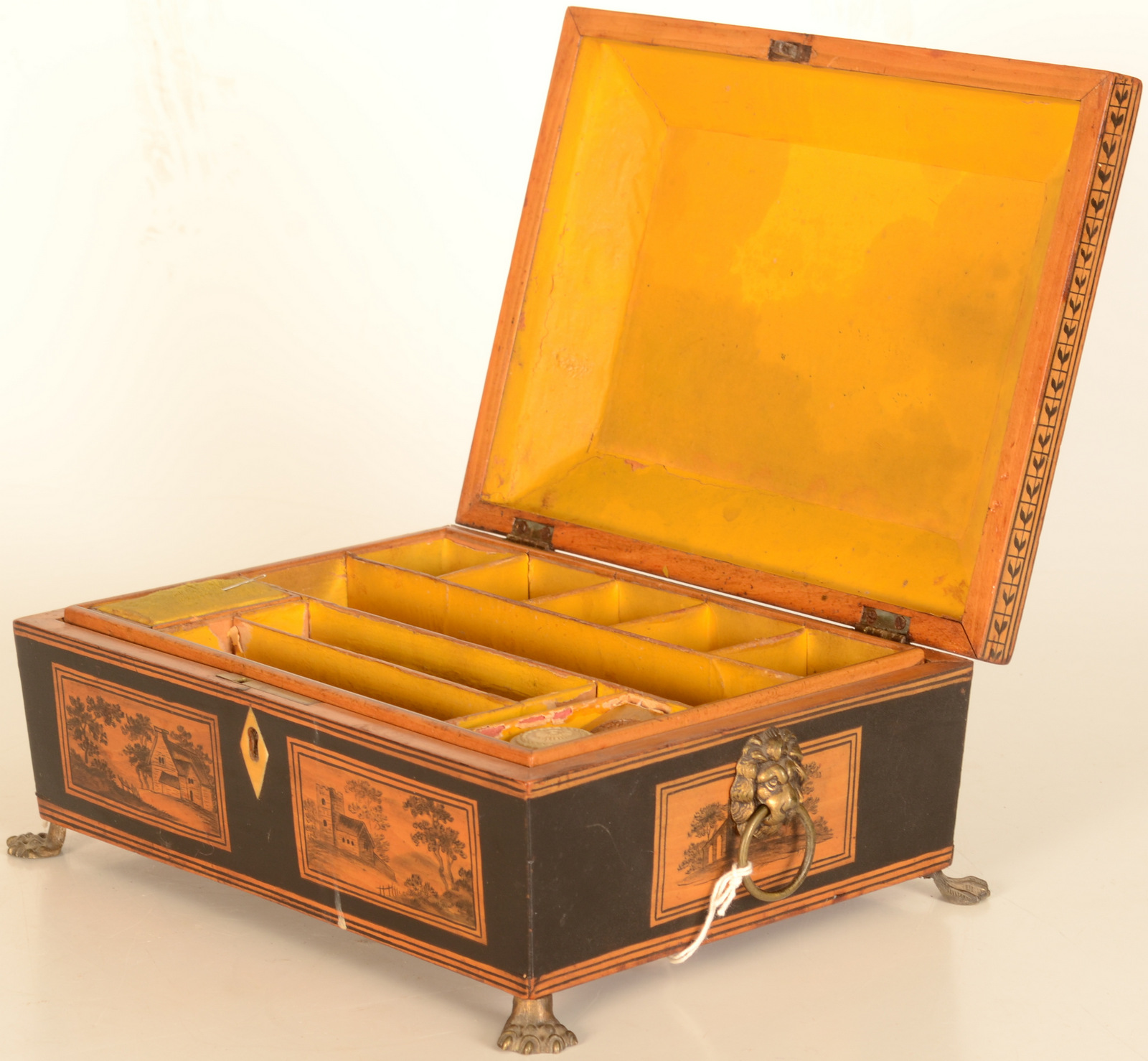 Lot 9 - A penwork box, early 19th century, the cover decorated with a cottage amongst trees,