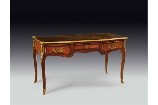A louis xv bois de rose and rosewood veneered bureau plat france