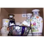 A Doulton Lambeth stoneware vase, a pair of Doulton Lambeth floral decorated vases, a Masons