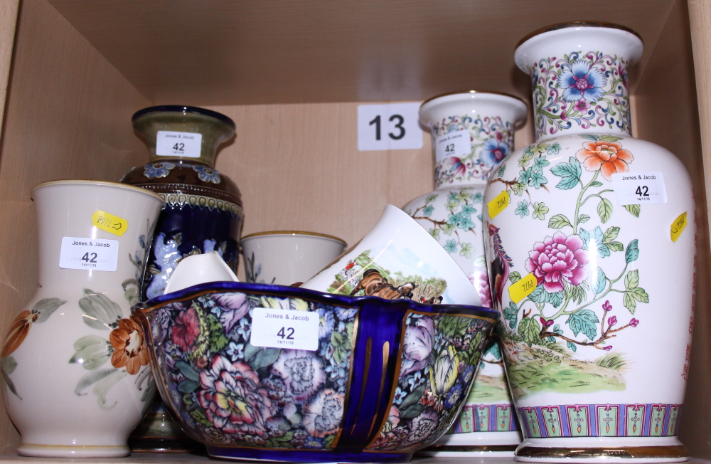Lot 42 - A Doulton Lambeth stoneware vase, a pair of Doulton Lambeth floral decorated vases, a Masons