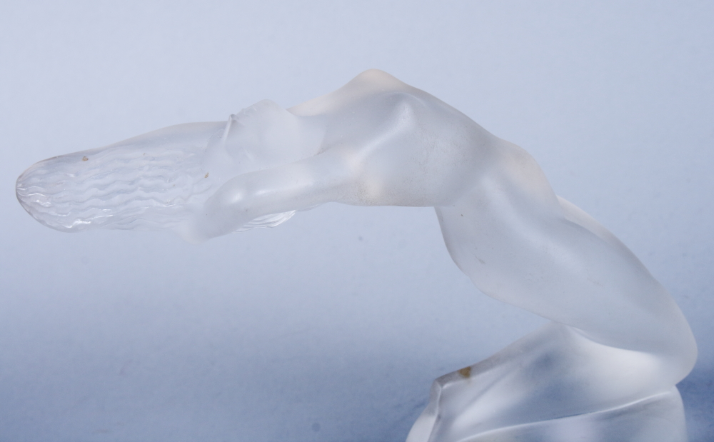 """Lot 50 - A Lalique frosted glass figure of a female nude, """"Chrysis"""", on a circular foot, etched mark and"""