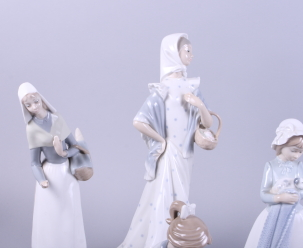 """Lot 34 - A Lladro figure, woman carrying a basket, 13 """" high, a similar Nao figure, and five Nao figures of"""