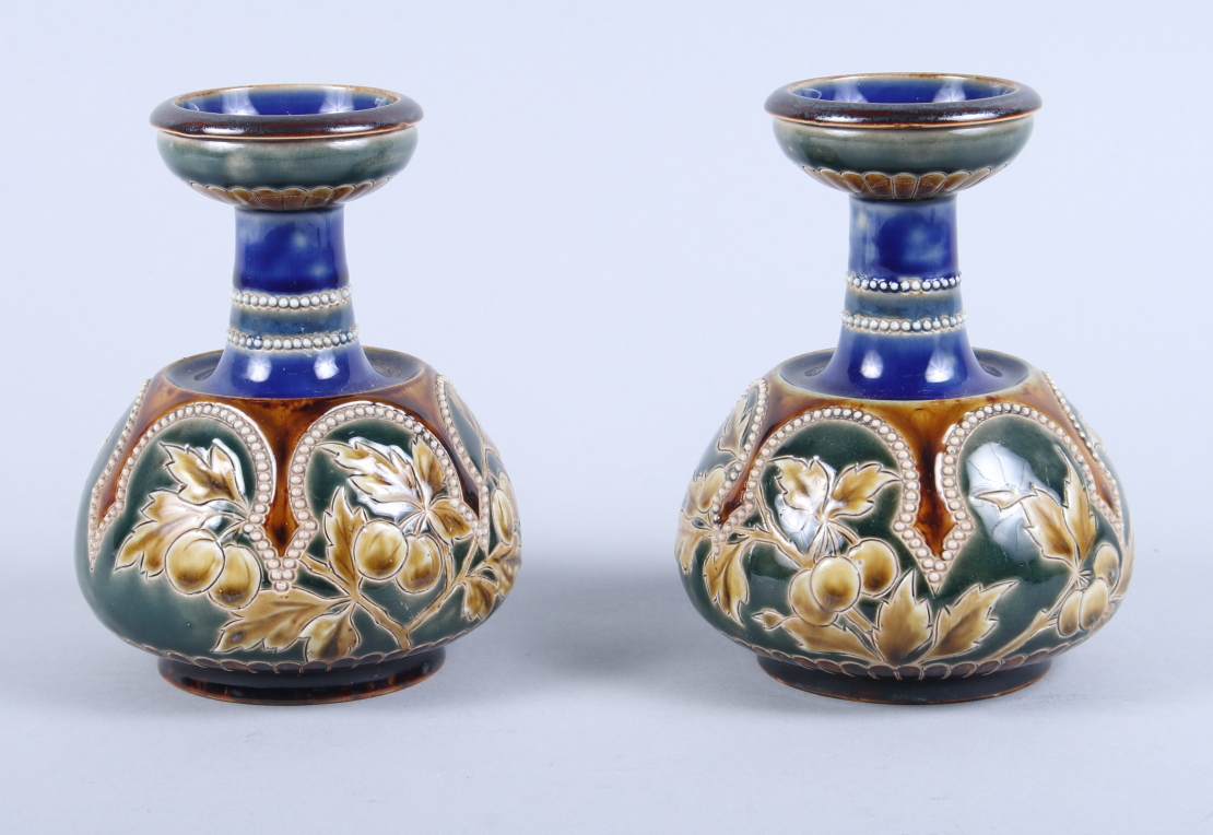 "Lot 40 - A pair of Doulton Lambeth baluster vases with leaf and berry decoration, 5 1/2"" high"