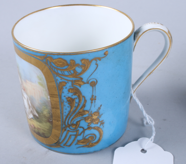 Lot 3 - A Sevres porcelain coffee can, single panel decorated young lovers, gilt highlights on a blue