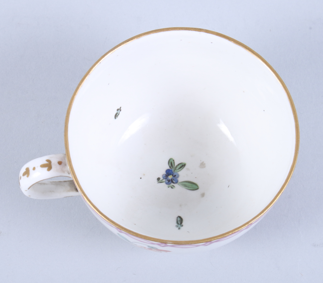 Lot 14 - An 18th century German porcelain cabinet cup, decorated bathing maiden (chip to foot rim)