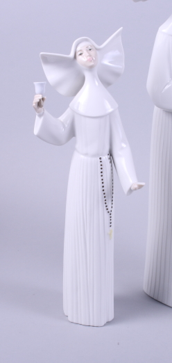 """Lot 32 - A Lladro figure group of two nuns, 13"""" high, and five other Lladro figures of nuns in various"""