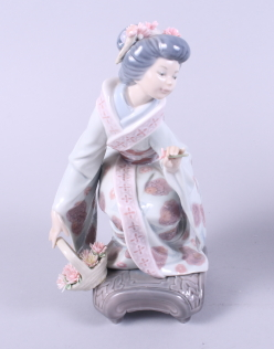 "Lot 30 - A Lladro figure group, ""Springtime in Japan"", on plinth, 12"" high, and a smaller Lladro figure of"