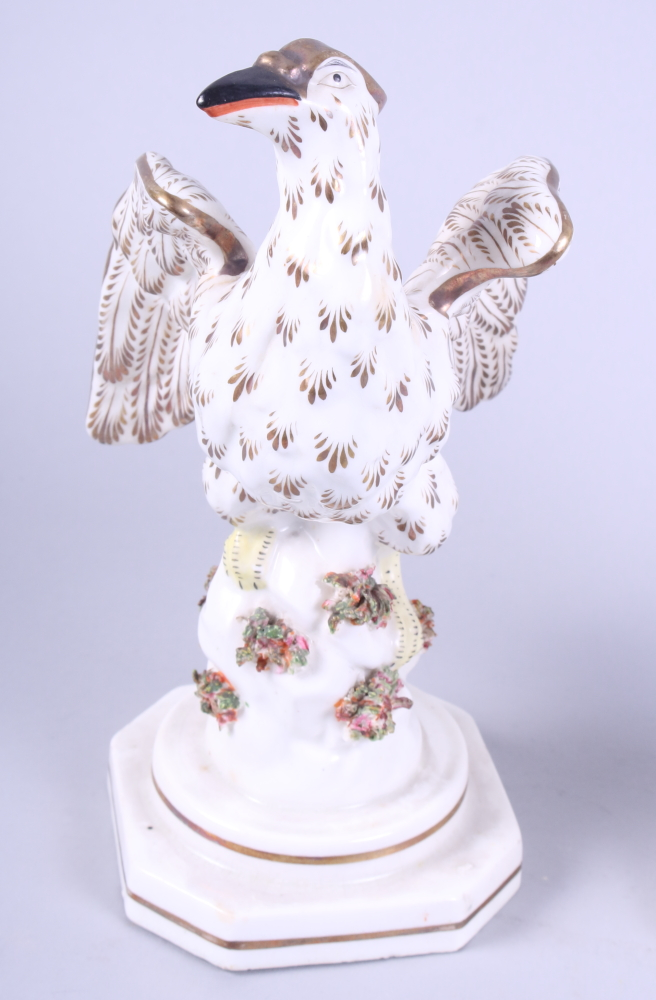 """Lot 4 - A pair of 19th century Staffordshire pottery eagles, 8"""" high"""