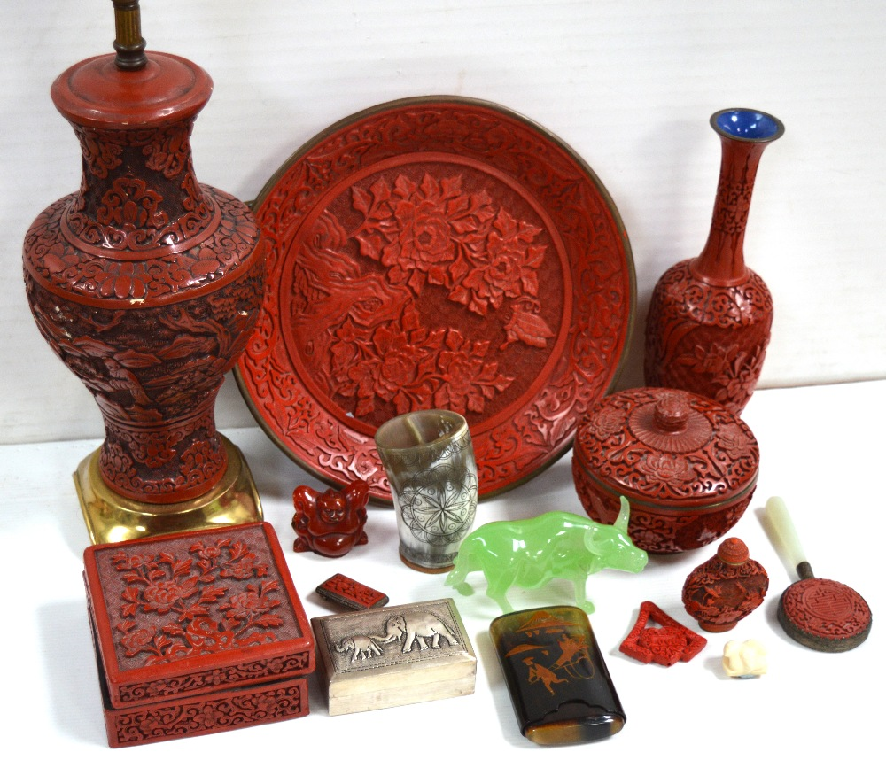 Lot 362 - A modern Oriental collectors lot comprising red lacquer items to include a vase, height 23cm,