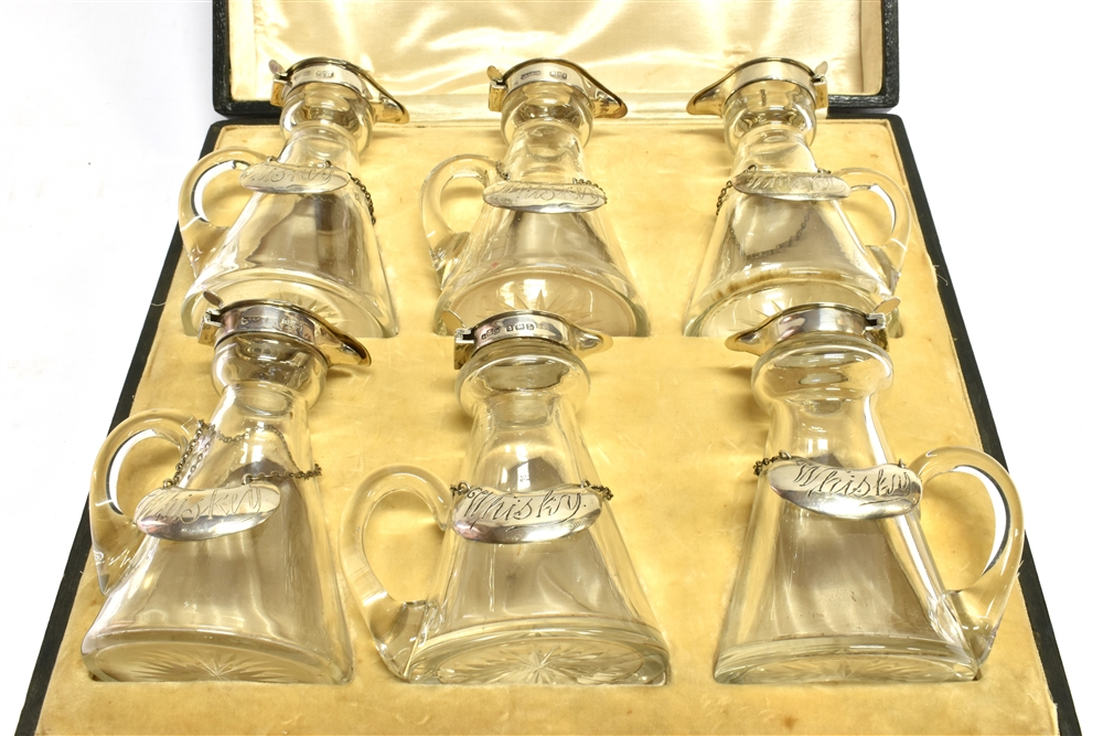 SIX SILVER MOUNTED CLEAR-GLASS CONICAL WHISKY NOGGINS AND SIX 'WHISKEY' LABELS each glass noggin