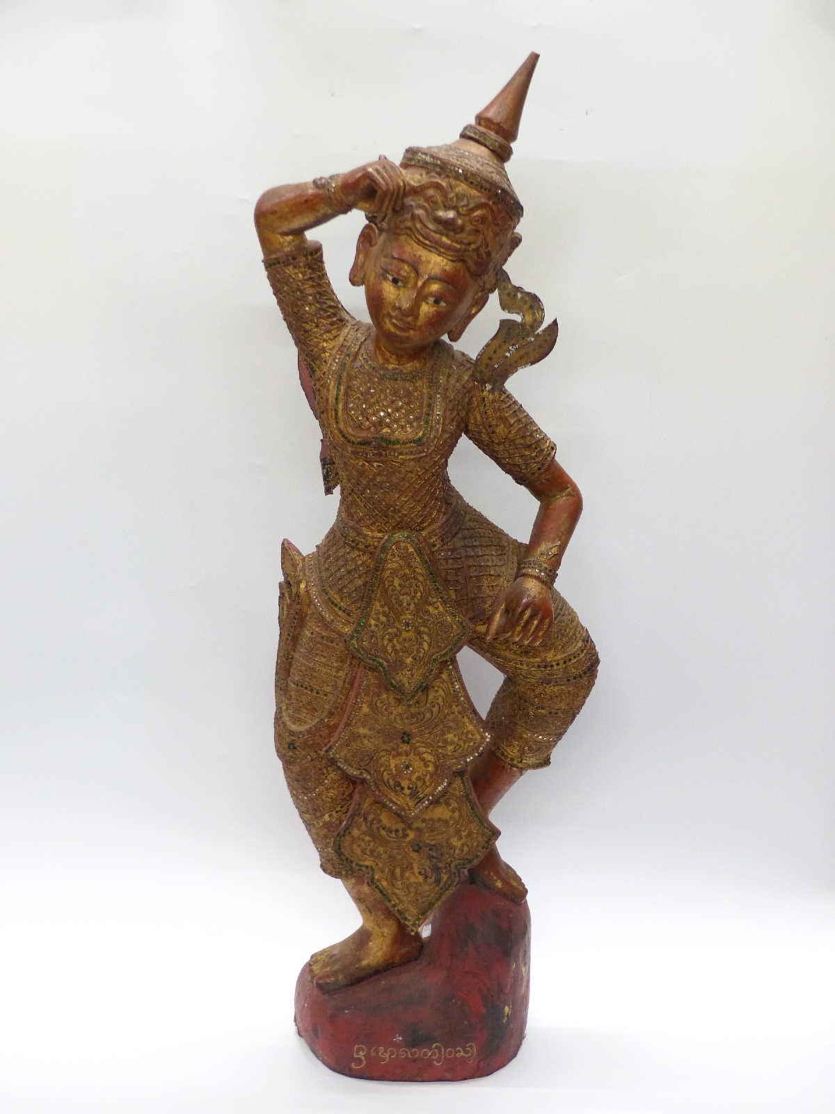 Lot 561 - A carved and gilded Cambodian Kinnaris Temple Dancer with script to base,