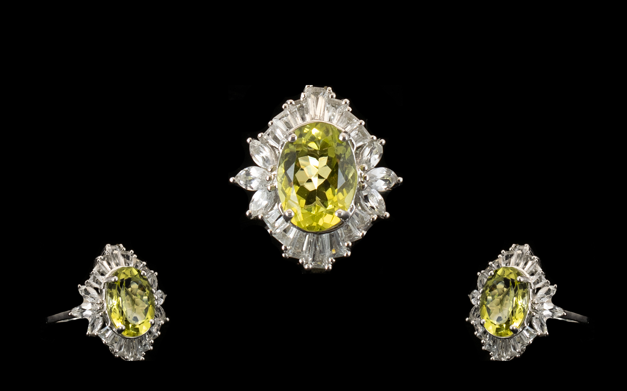 Ouro Verde Quartz and Topaz Statement Ring, an oval cut natural green gold quartz of 6cts, framed