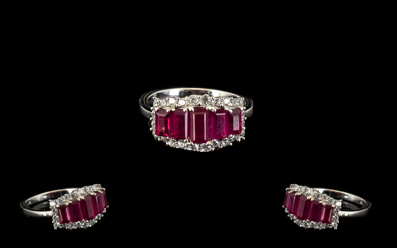 Lot 312 - Ruby and Zircon Graduated Band Ring, comprising five graduated baguette cut rubies of good and