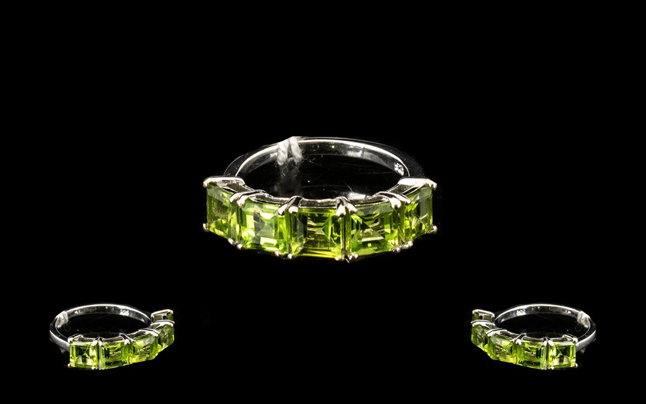 Lot 310 - Peridot Band Ring, five square cut peridots, totalling 3.