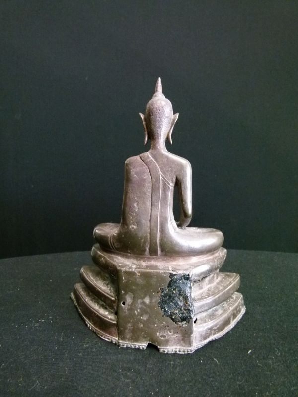 Lot 303 - Bronze figure of a seated Buddha, possibly 18th/19th Cambodian, on a stepped shaped base, 20cm