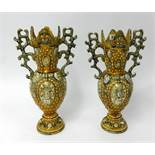 A pair of ornate Victorian pottery vases, height 42cm.
