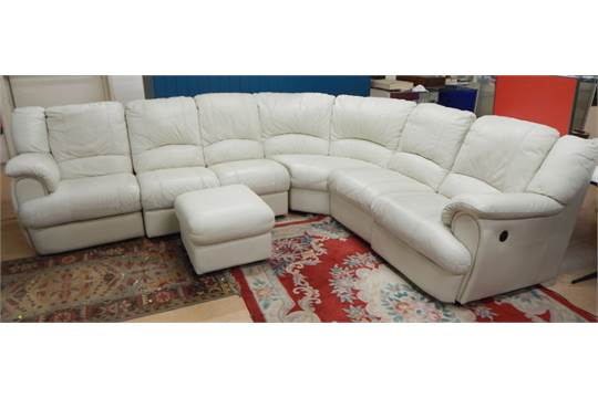 A Modern Italian Cream Leather Corner Sofa Unit Bearing Label For La Meteora With Two Electric