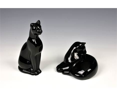 A Baccarat black crystal seated Egyptian cat, modelled by Georges Chevalier, acid stamped to base, 6¼in. (19.9cm.) high, toge