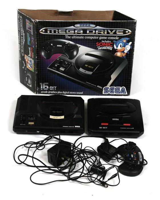 A 16 bit Sega Mega Drive; together with a Sega Mega Drive II.