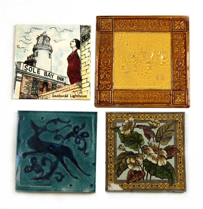 Lot 26 - A group of four tiles, the largest 19 by 19cms (7.5 by 7.5ins).