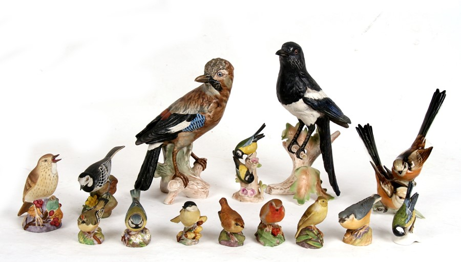 Lot 55 - A group of porcelain birds to include Royal Worcester, Goebel and Crown Staffordshire, the largest