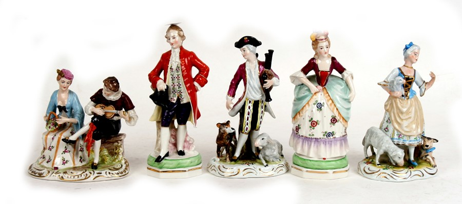 Five Meissen style figures and groups, the largest 19cms (7.5ins) high (5).