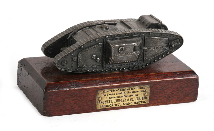 Lot 277 - A rare WW1 tank desk ornament mounted on a hardwood base with engraved brass plaque which reads: