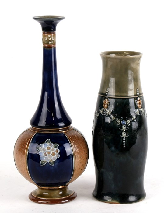 A Royal Doulton Stoneware vase decorated with flower swags, 23cms (9ins) high; together with a