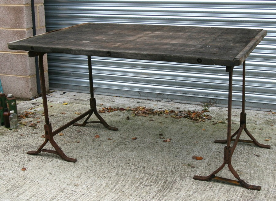 An industrial style heart oak garden table, 141cms (55.5ins) wide.