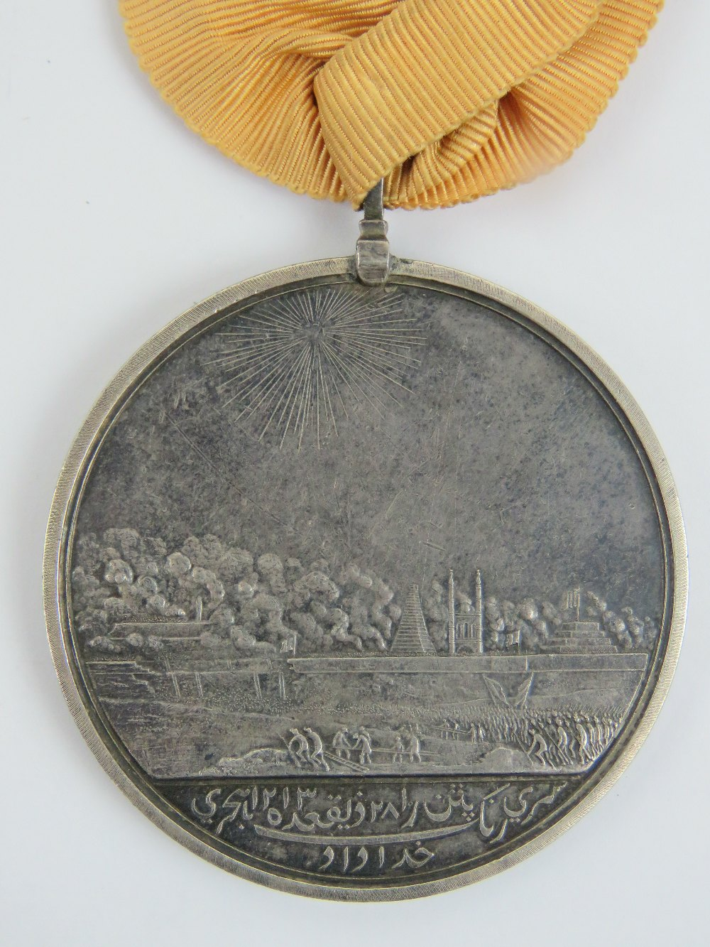 An Honourable East India Company medal for Seringapatam 1799, with ribbon, silver, 48mm, Soho Mint. - Image 2 of 2