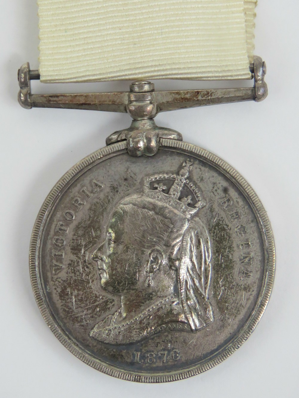 An Arctic medal with ribbon; British Arctic Expeditions of 1875-76, 'J. Cooper Pv OFFr 2 C? H.M.