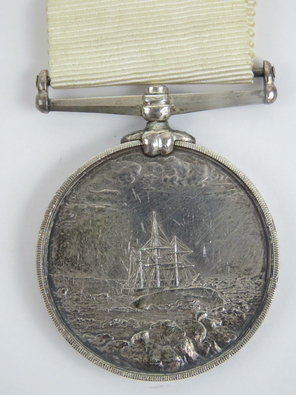 An Arctic medal with ribbon; British Arctic Expeditions of 1875-76, 'J. Cooper Pv OFFr 2 C? H.M. - Image 2 of 6