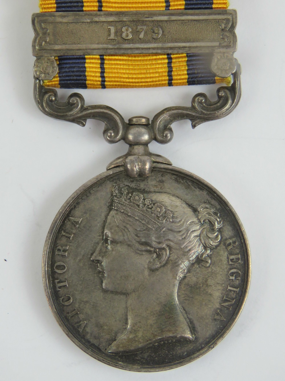 A South African Zulu war medal (1880) with ribbon and bar for 1879,