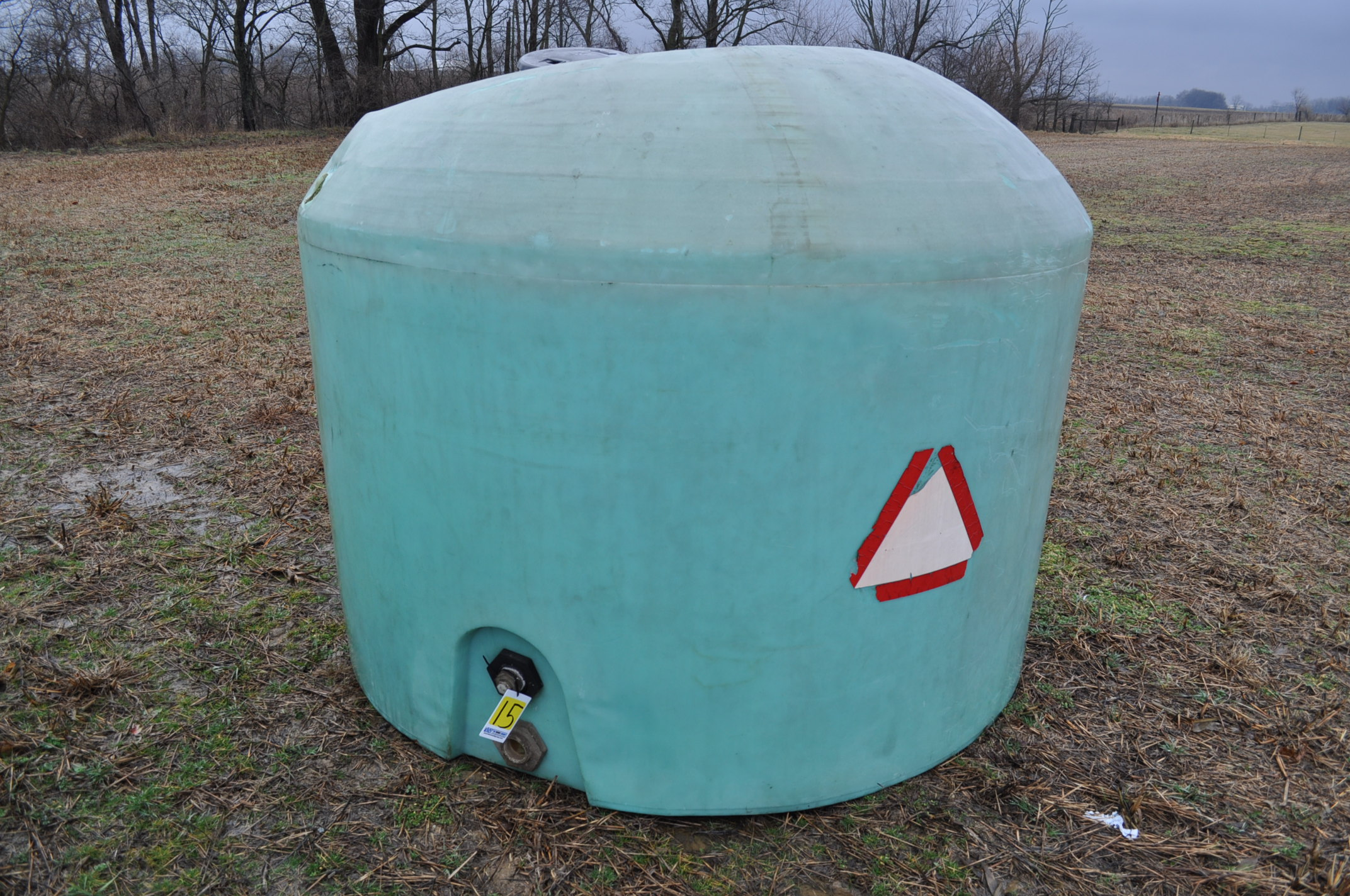 1200 gallon flat bottom poly tank, hole in top